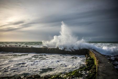 Wave hitting the Dombret basin in la Chaume (Les Sables dOlonne, France)
