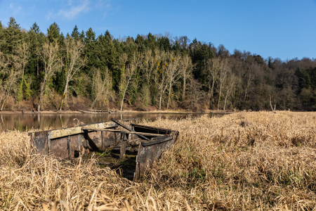 Wreck of a small boat on the shores of the Jaunay lake (Vendee, France)