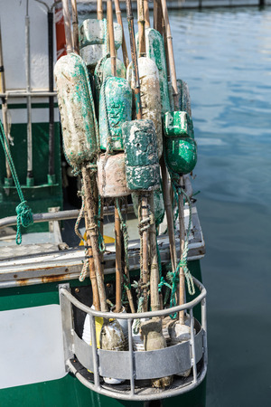 Used floats for fishing net at the rear of the boat Stock Photo