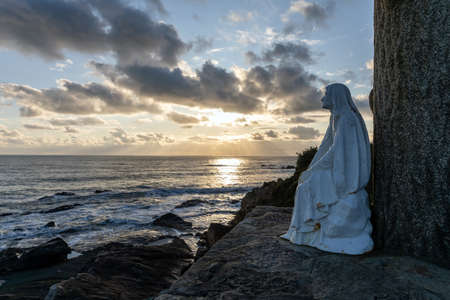 Virgin praying for sailors at the entrance of the port of Les Sables d'Olonne (Vendee, France)