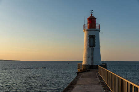 Lighthouse of the great jetty of Sables d'Olonne at dawn (Vendee, France) 版權商用圖片