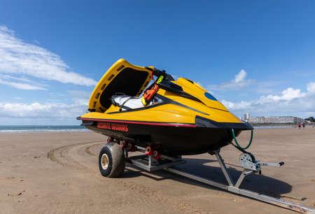 Coast guard rescue vehicle on the sand of Les Sables d'Olonne beach (Vendee, France)
