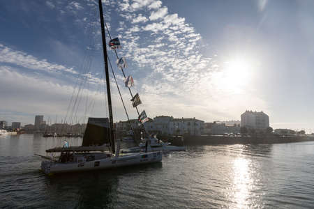 LES SABLES D'OLONNE, FRANCE - NOVEMBER 08, 2020: Jean Le Cam boat (Yes We Cam) in the channel for the start of the Vendee Globe 2020 on November 08,2020. in Les Sables d'Olonne, France.