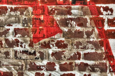 Wall of red bricks with rest of white color.
