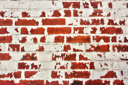 Abstract Background, Wall of red bricks with rest of white color. Stock Photo