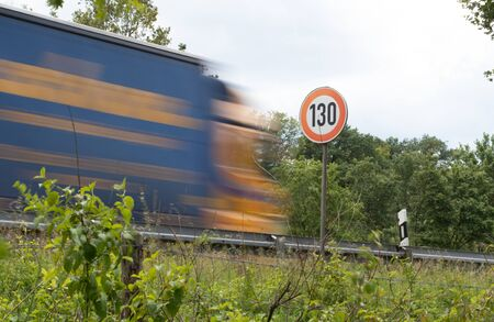 Tempo 130, road sign with truck, highway