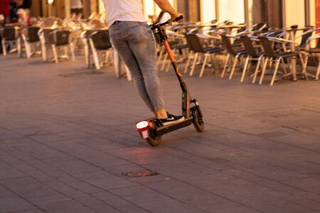 Cologne, Germany - 07-24-2019, e-scooter in city, man