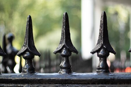 Spearheads on a fence, blurred background 스톡 콘텐츠
