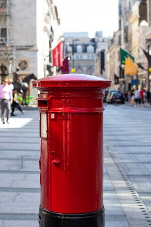 English postbox in a shopping street Stock Photo