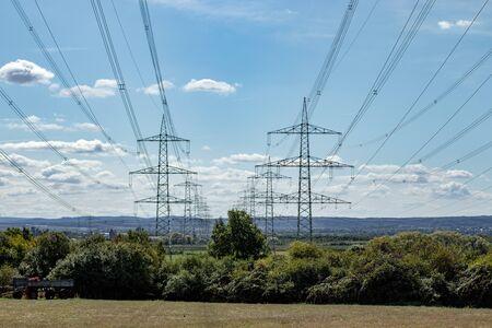 power line in farmland, landscape Standard-Bild