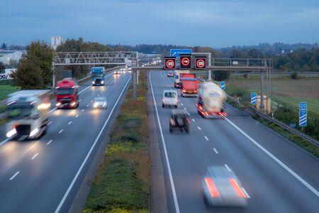 german autobahn A61 at dawn, rush hour, speed limit 120