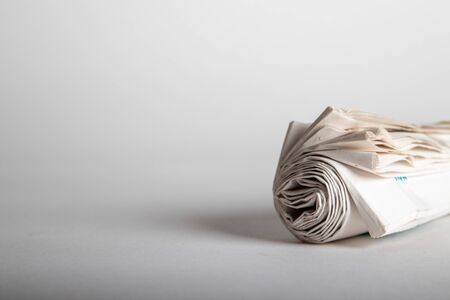 newspaper roll with white background, negative space Banque d'images
