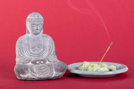sitting buddha with incense sticks, relax