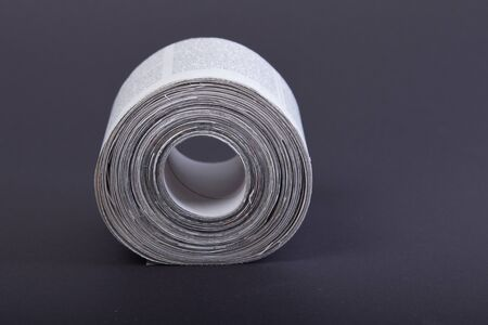 toilet paper made out of newspapers, alternative toilet paper, isolated on black, newspaper roll, close-up