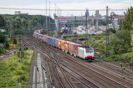 Huerth, NRW, Germany, 06 27 2020, cargo train before skyline of cologne, container station cologne Eifeltor, outdoor