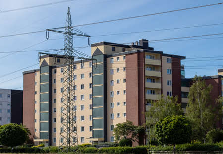 Huerth, NRW, Germany , 31 05 2020, high appartment building, powerlines in front of the building, cloudy sky