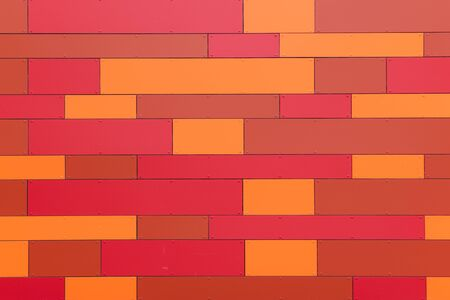 Rectangular pattern in different shades of red as a background, orange and red