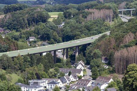 German highway bridge nearby a small village, outdoors Archivio Fotografico
