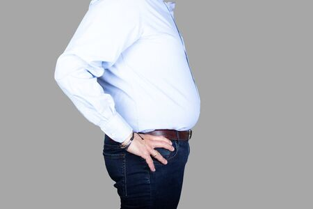 man with a big belly wearing a shirt and jeans, side view