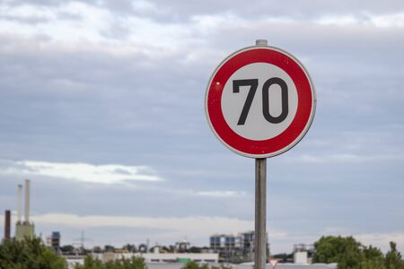 German road sign zone 70 km / h in a rural area, outdoors