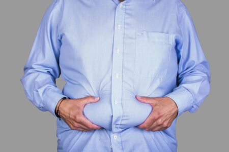 man with overweight and a big belly wearing  a shirt, holding his wheatwamp, diet