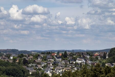 view over a village, rooftops, hills in the background, outdoors Stock Photo