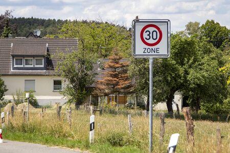 German road sign zone 30 km / h in a rural area, outdoors Foto de archivo
