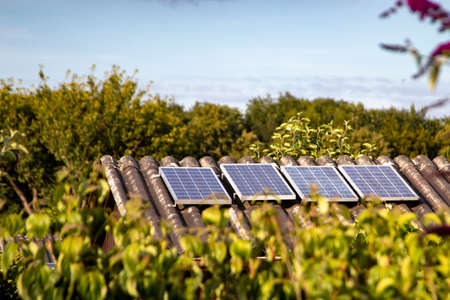 solar panels on a small house roof, allotment garden