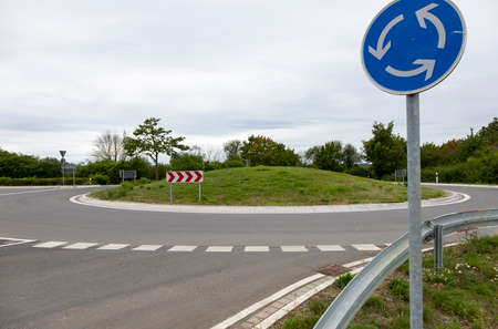 roundabout without cars with a sign that indicates it, cloudy day
