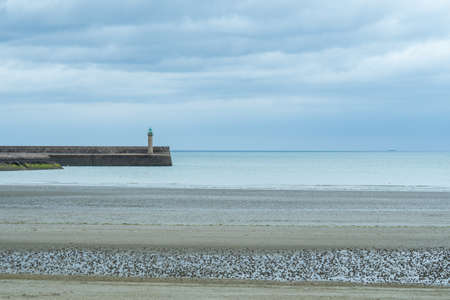 Beautiful beach at the Brittany Atlantic coast, France, with wave-breaker. Banque d'images