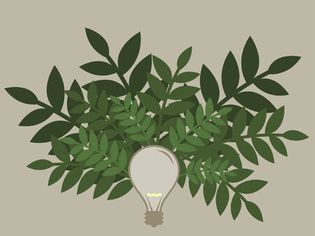 A light bulb covered in green plants for energy saving.