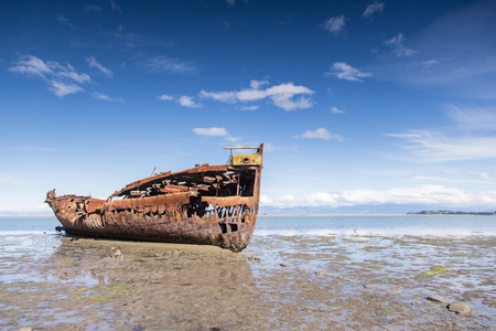 outflow: Broken boat in Motueka Stock Photo