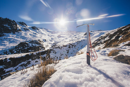 Climbing Mount Somers with ice axe, Canterbury, New Zealand Stock Photo
