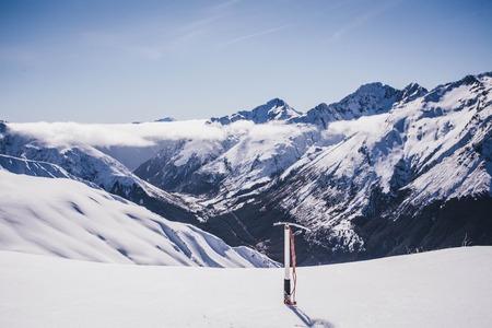 Climbing avalanche peak with ice axe.  Arthurs Pass, Southern Alps, Canterbury, New Zealand Stock Photo