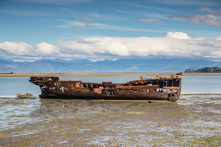 Broken boat in Motueka Stock Photo