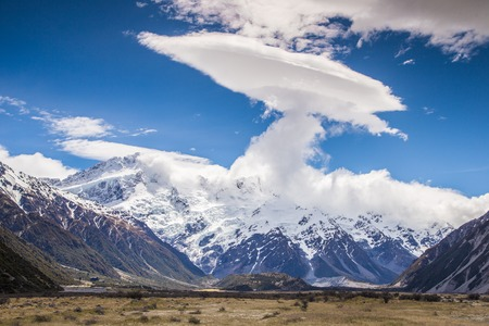 Amazing Cloud with Mount Sealy at Aoraki Mount Cook National Park,Mackenzie District, Canterbury, New Zealand Stock Photo