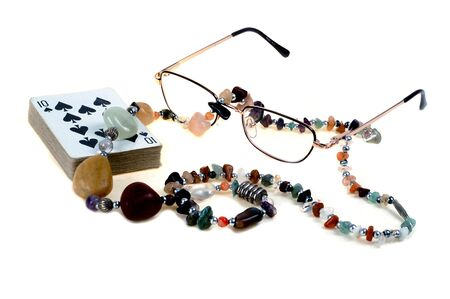 Cards, Nacklace and Glasses on white backgraund photo