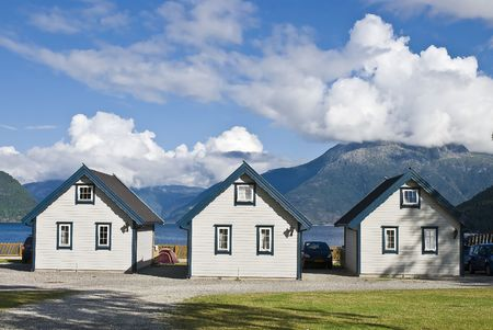 fjord: Three rental cottages in beautiful Norwegian fjord! Stock Photo