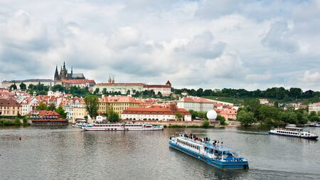 View from bridge over Prague and boats with tourists Standard-Bild