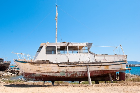 A boat on land ready for repair
