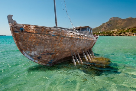 old boat: An old ship wreck on a cliff. Stock Photo