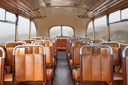 Inside a vintage bus on a country road Standard-Bild
