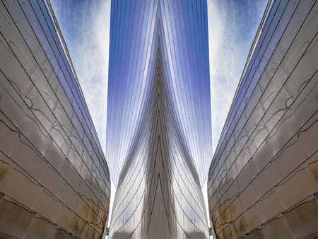 Architectural Abstract, A metal clad building is altered to resemble the prow of a ship between two walls.