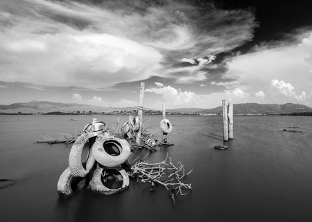Black and White Lake and clouds with Tires