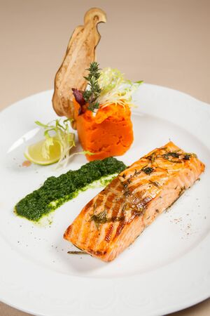 Salmon fillet with carrot puree photo