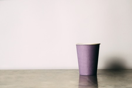 decaffeinated: Paper cup on the table