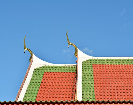 apex: temple and  gable apex on blue sky background
