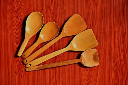 turner: Rice scoop and wooden spatula on brown wood floor