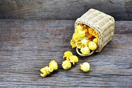 PopcornCorn caramel butter in basket on old wooden floor