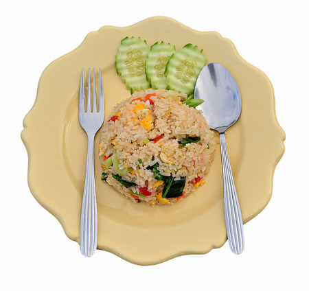 American fried rice In a plate of yellow rice On a white background